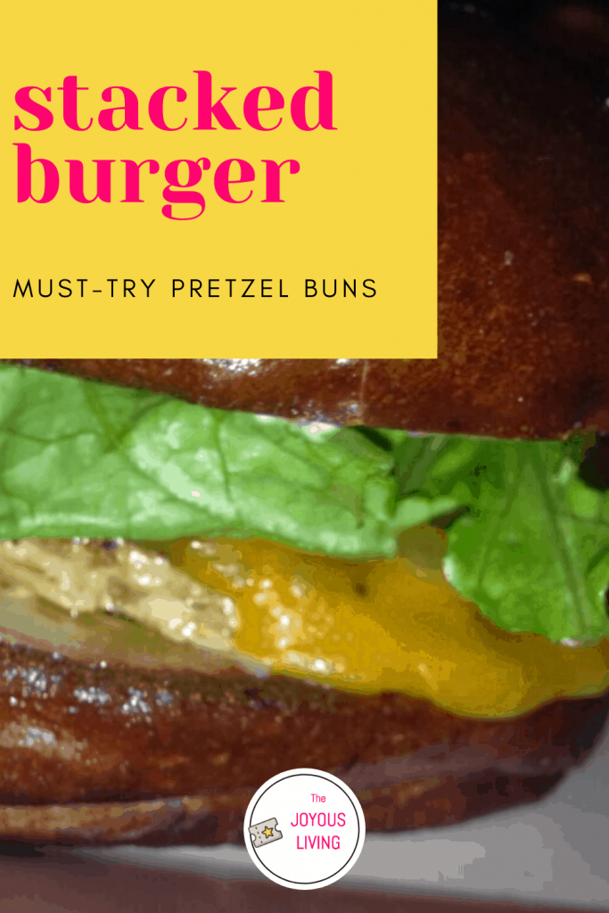 must-try pretzel buns #nationalburgerday #burger #food #pretzel #bun #restaurant #stackedburger #stacked #thejoyousliving